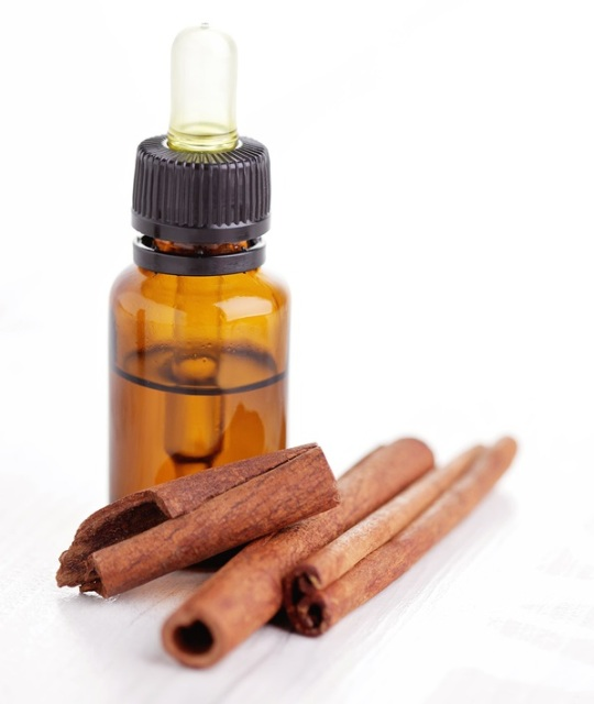 bottle of cinnamon aromatherapy oil - beauty treatment